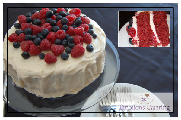 Delicious Red Velvet Cake topped with Cream Cheese Icing and Fresh Fruits